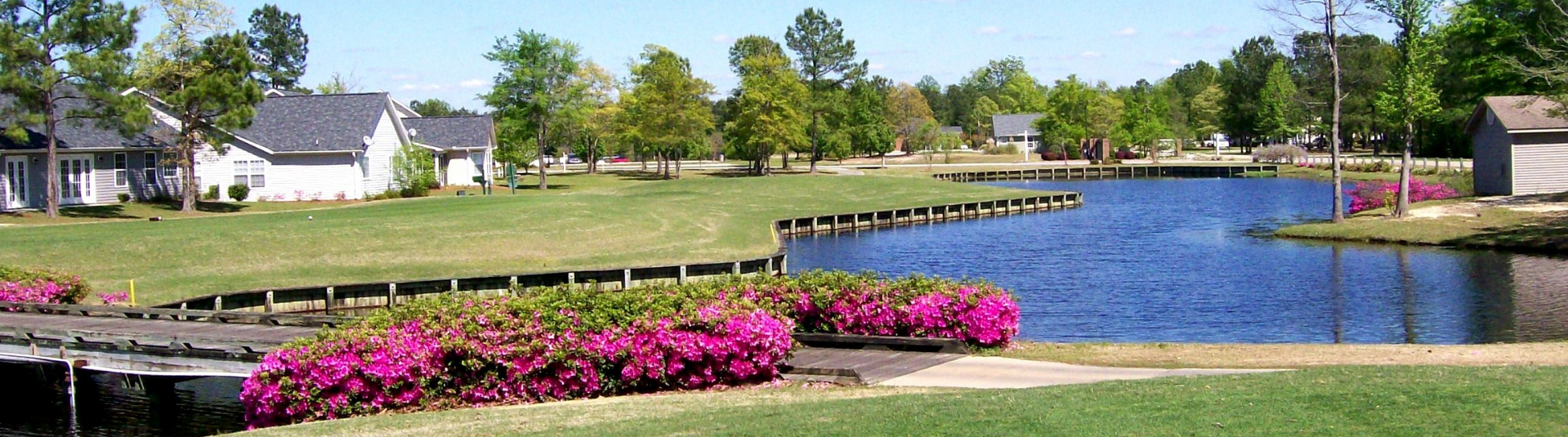 Azaleas line a bridge over a pond at Wyboo Golf Club